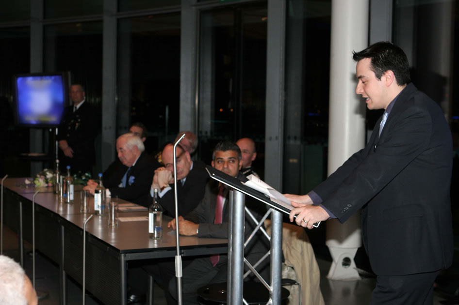 Neil speaking on top floor of City Hall, London with guests seated